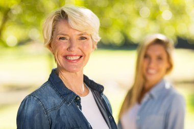 woman standing in front of daughter