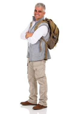 Middle aged hiker with backpack