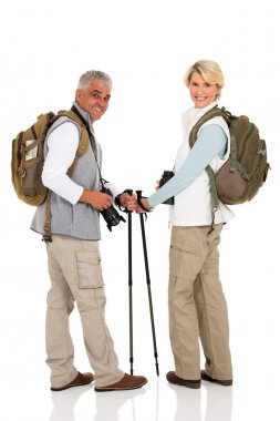 mid age couple with backpacks