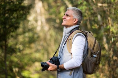 Man hiking with dslr camera
