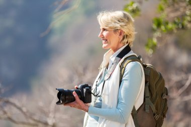 Woman hiking with dslr camera
