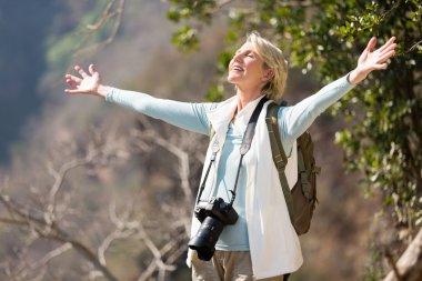 Senior female on top of mountain