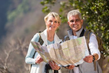 hikers holding map