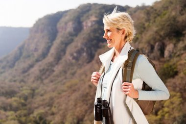 woman on mountain with binoculars