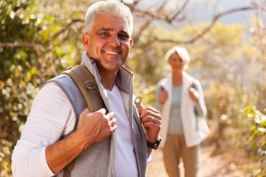 Man hiking with wife