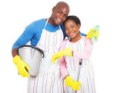 Photo couple holding cleaning tools