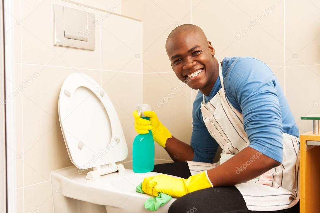Man Cleaning Toilet Stock Photo Michaeljung - Bathroom cleaner person