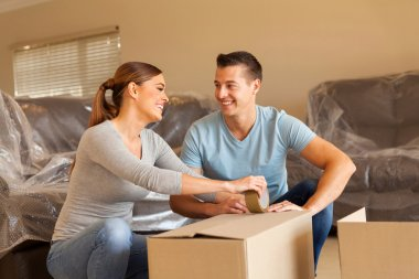 couple with boxes in new home