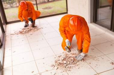builders removing old floor tiles