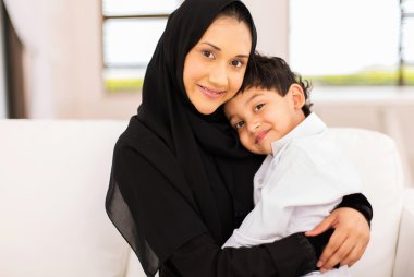 woman sitting on couch with son