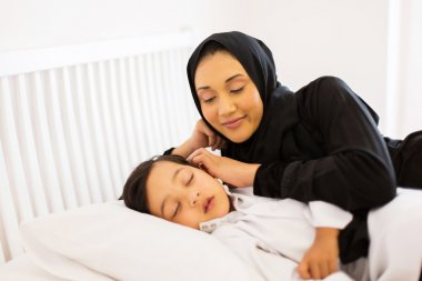mother with son sleeping in bed