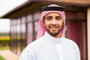 arabian man standing near house