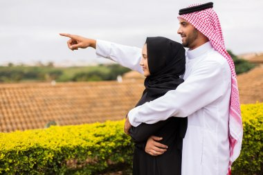 Middle eastern couple pointing