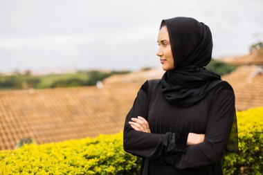 muslim woman with arms crossed