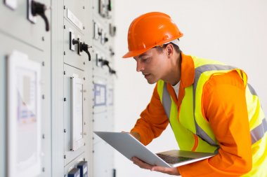 technical worker using laptop computer