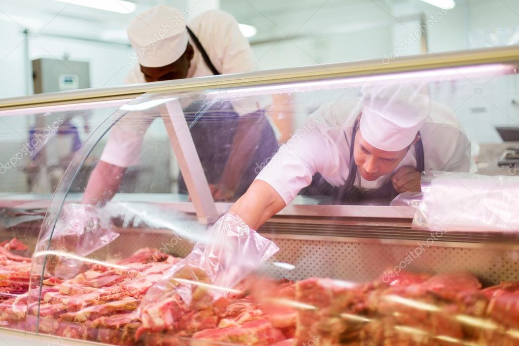 Butchers Working In Butchery Stock Photo