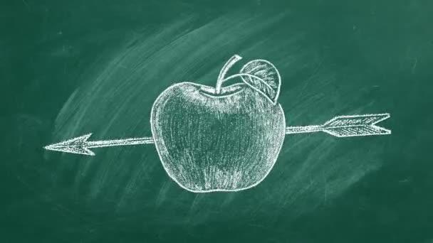 Zralé jablko se šipkou na tabuli.