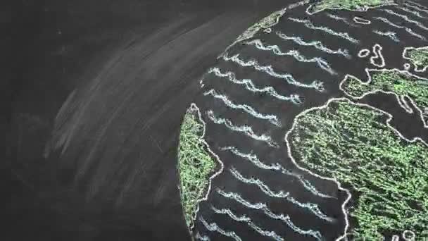 Forgó földgömb az iskolai táblán