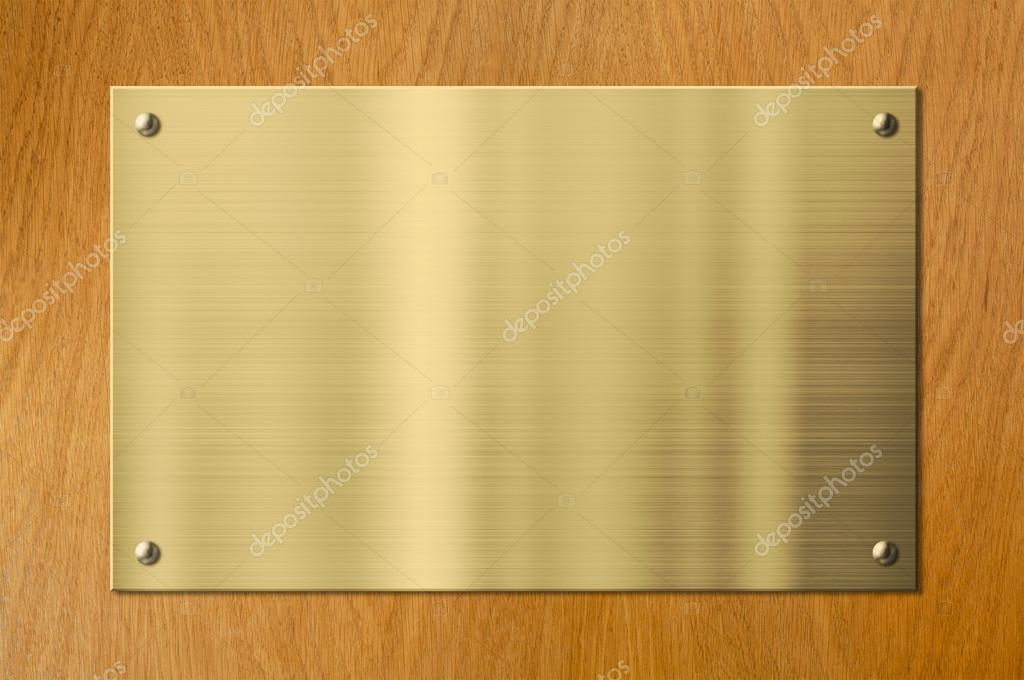 gold or brass metal plaque on wood background stock. Black Bedroom Furniture Sets. Home Design Ideas