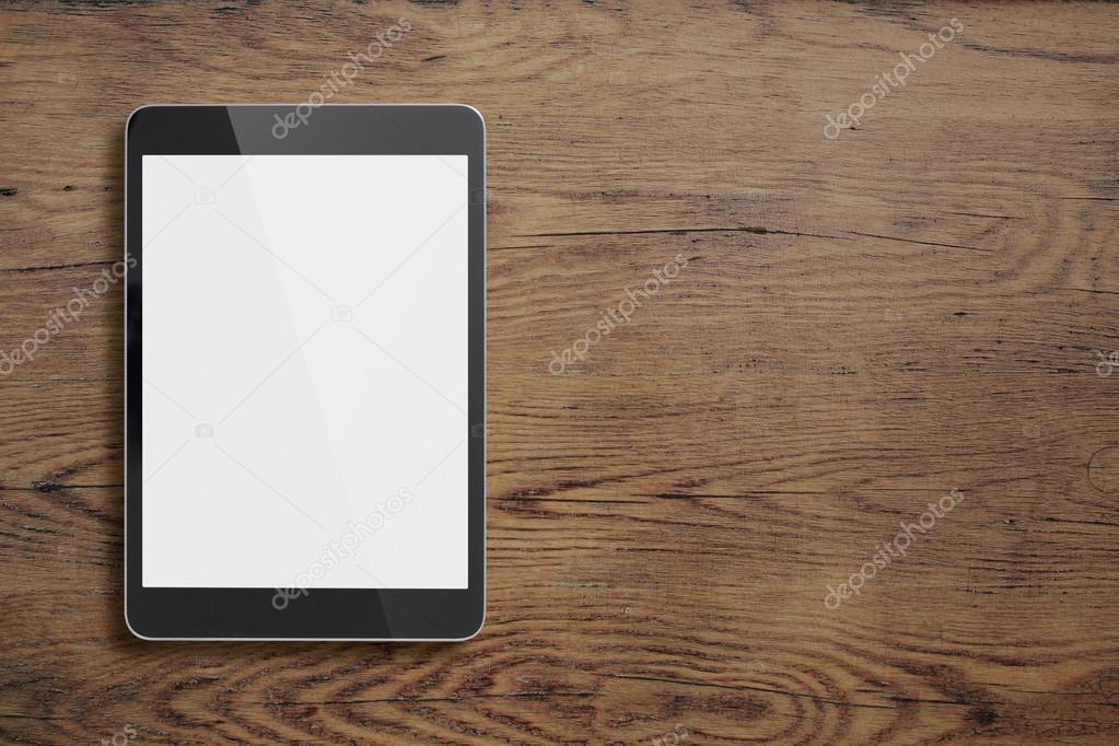 Zwarte tablet pc op oude houten tafel achtergrond u stockfoto