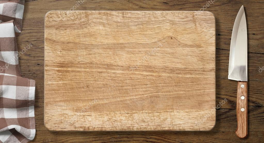 Cutting Board And Knife On Old Wood Table With Picnic Tablecloth Background  U2014 Photo By Andrey_Kuzmin