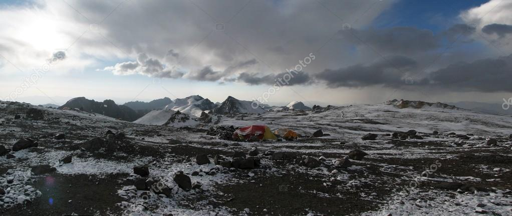 Tents under snow in the camp, Andes
