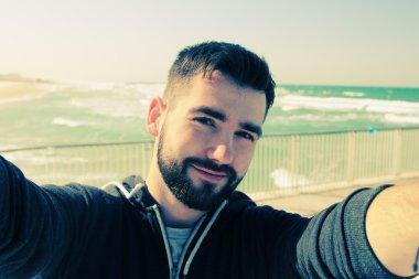 Selfie portrait of young man