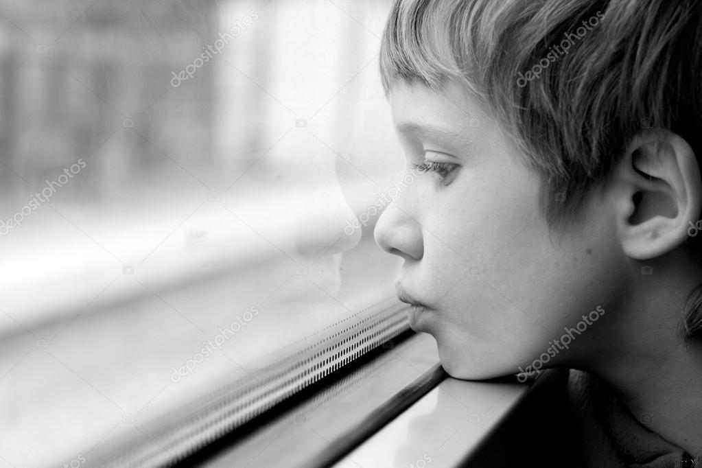 Boy Looking Through Window Boy Looking Through Window Stock Photo C Dubova 66302777