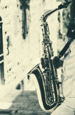 Fotografie Saxophonist playing on saxophone