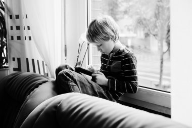little boy playing tablet