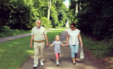Grandparents With Grandchild  in the park