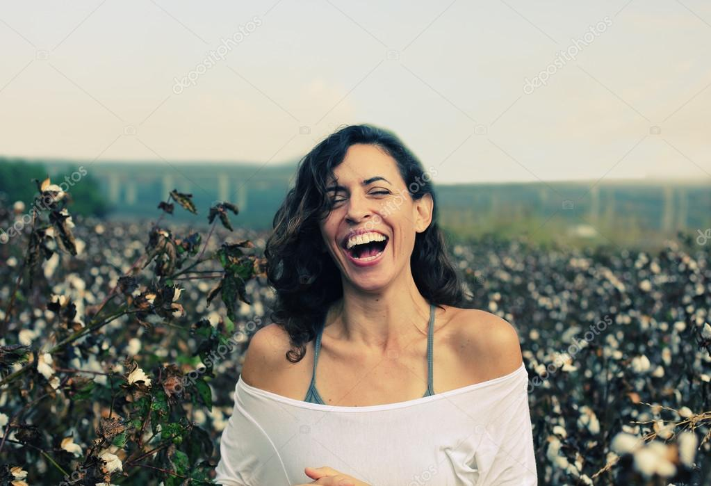 Woman standing in cotton field
