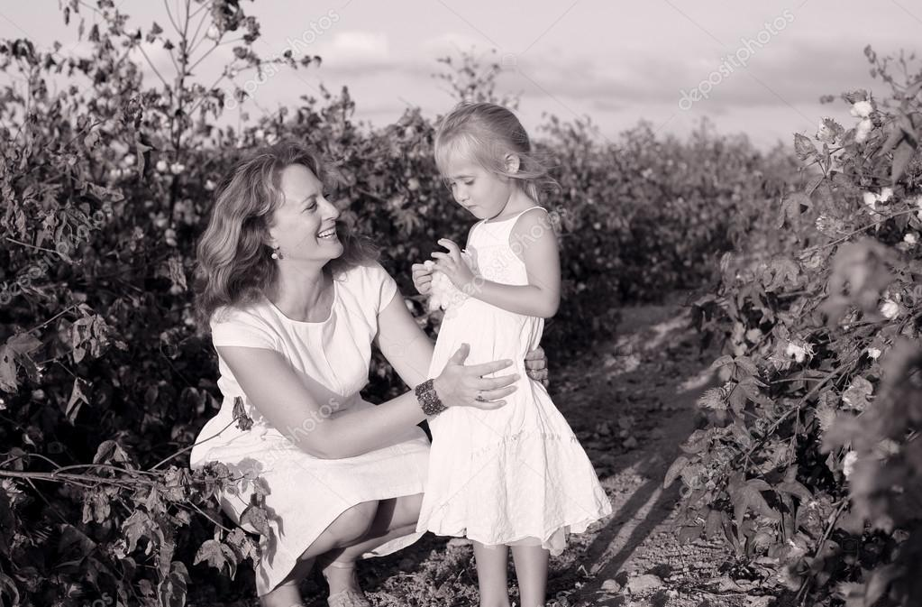 Mother with daughter in cotton field