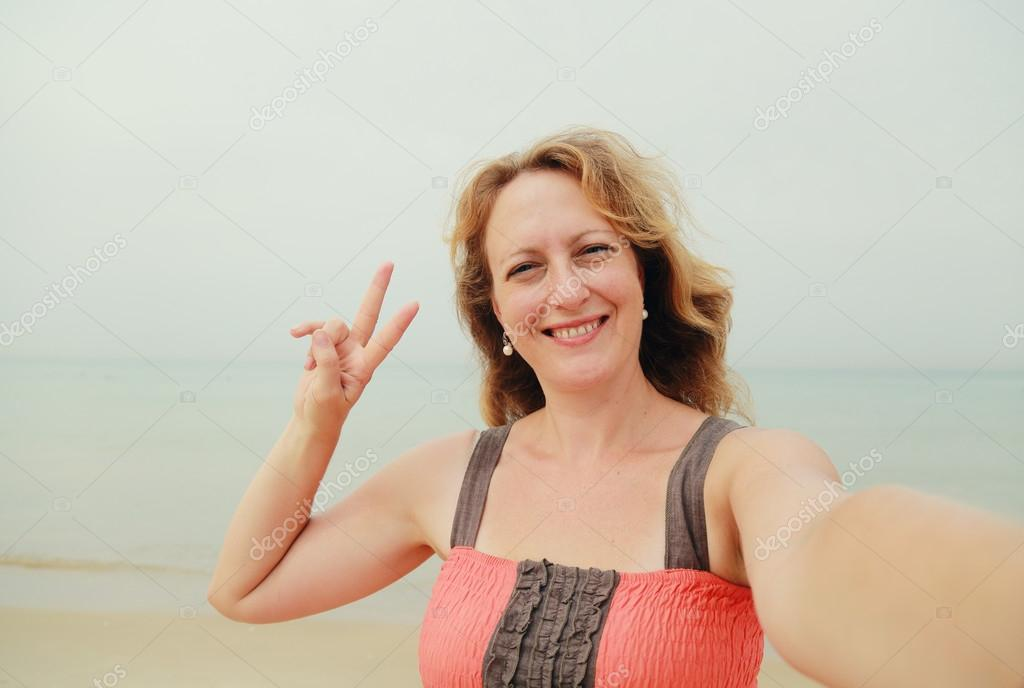 Woman walking on the shore of the beach