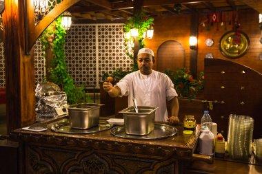 Chef of street cafe in Dubai Marina