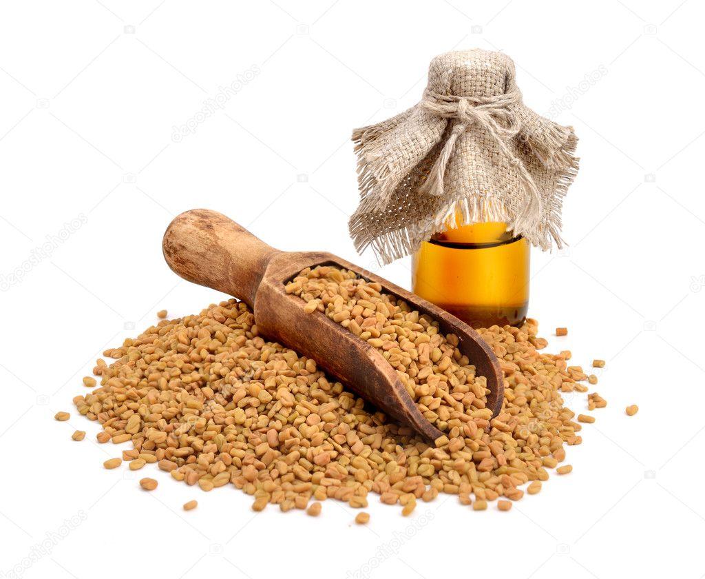 Fenugreek seed with pharmaceutical bottle. (Trigonella foenum-gr