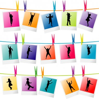 Colorful photo frames with children silhouettes hanging on a rop