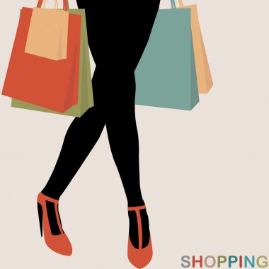 Shopping concept with woman silhouette carrying shopping bags