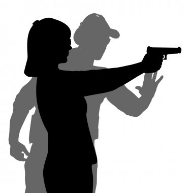 Instructor assisting woman aiming hand gun at firing range