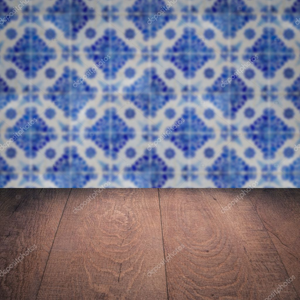 Wood table top and blur vintage ceramic tile pattern wall — Stock ...