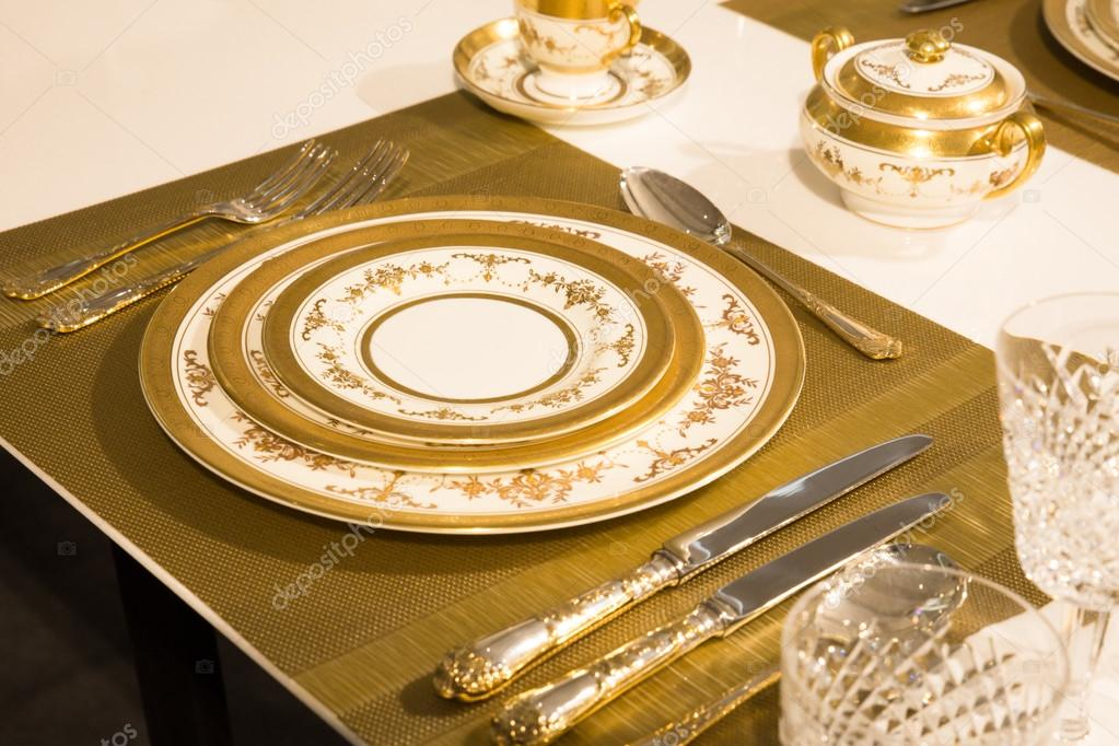 Elegant gold and white china plates in setting \u2014 Photo by littleny & Elegant China Setting \u2014 Stock Photo © littleny #55732043