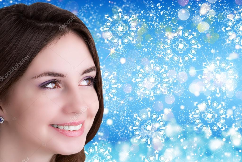 beauty people and health concept beautiful young women face over blue christmas background stock photo c alex150770 60695461 https depositphotos com 60695461 stock photo beauty people and health concept html