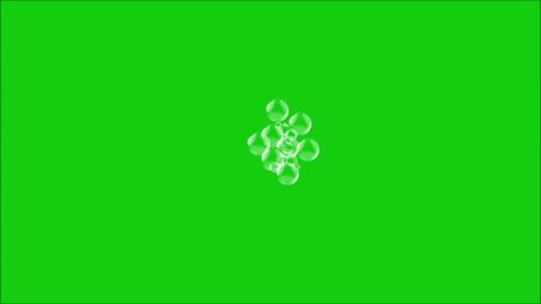 Abstraktní chaotický pohyb mýdlové bubliny na zeleném pozadí. Animace