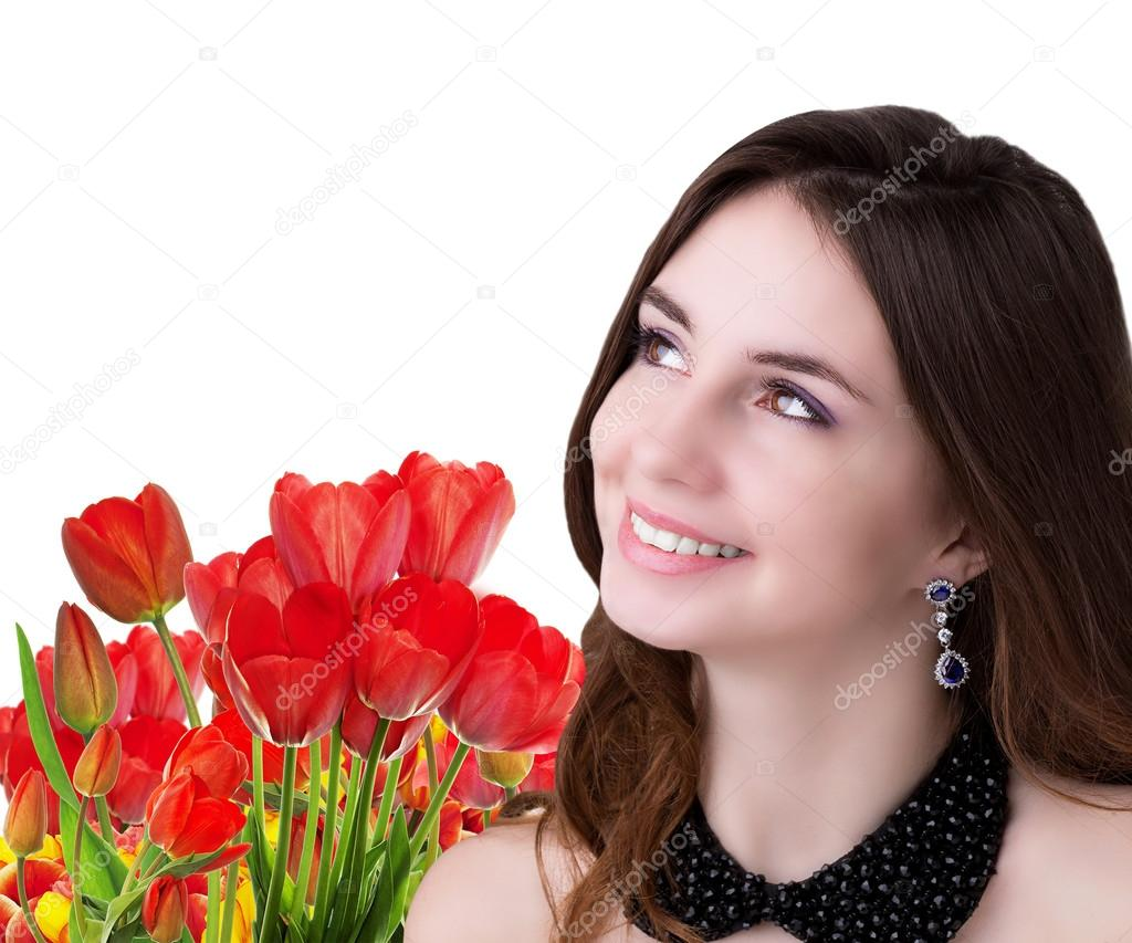 Young beauty Girl with Beautiful garden fresh colorful tulips on