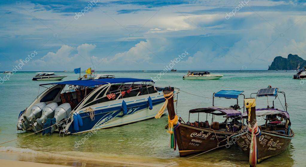 Traditional Thai Longtail boats vs speed boats