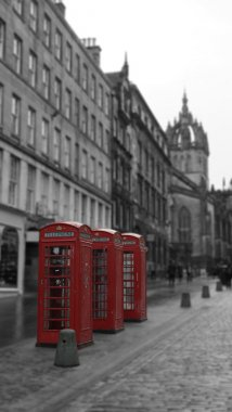 Three British Phone Booths on Royal Mile street in Edinburgh, Scotland