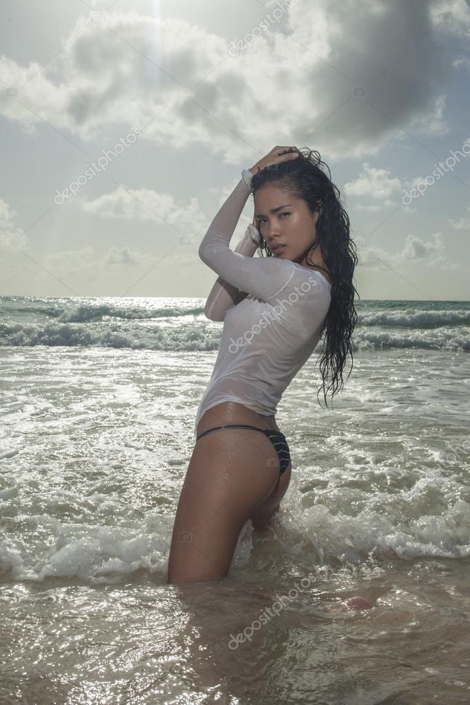 Asian girl in shirt t wet