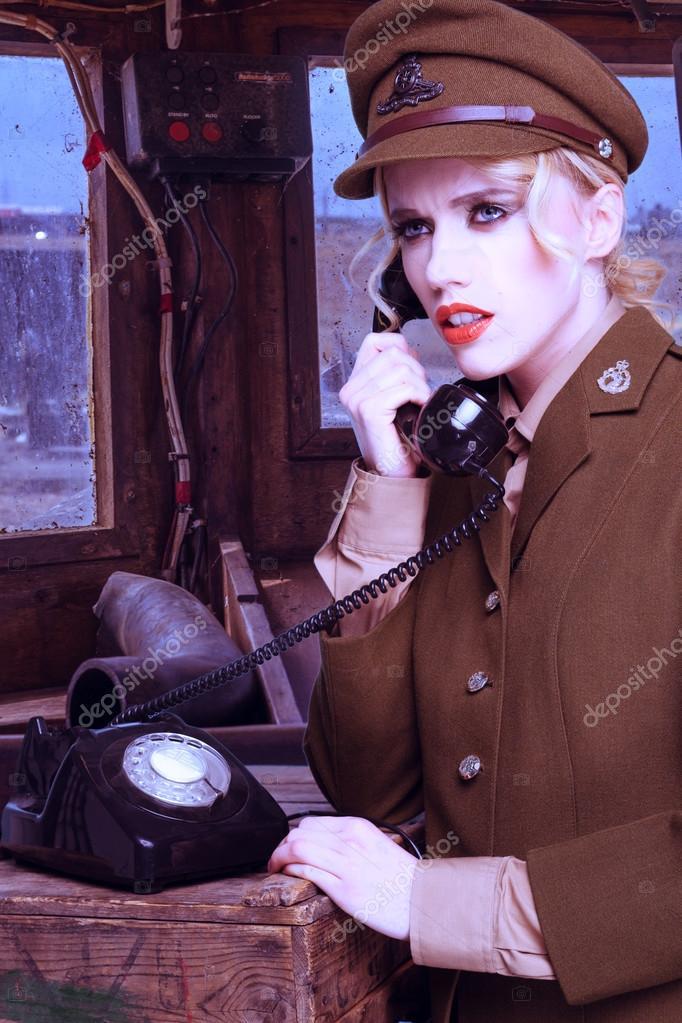 Pretty blond woman in army uniform