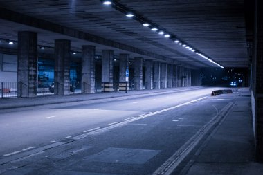 Covered Street Illuminated at Night