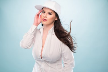 Woman in White Fashion with Cap Showing Cleavage